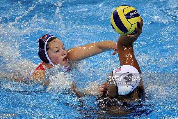 Brenda Villa of the US vies for the ball with Lefke van Belkum of the Netherlands during the gold medal waterpolo match of the 2008 Beijing Olympics...