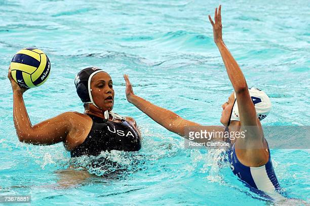 Brenda Villa of United States looks for a pass over Sofia Iosifidou of Greece in the Women's Preliminary Round Group C Water Polo match between...