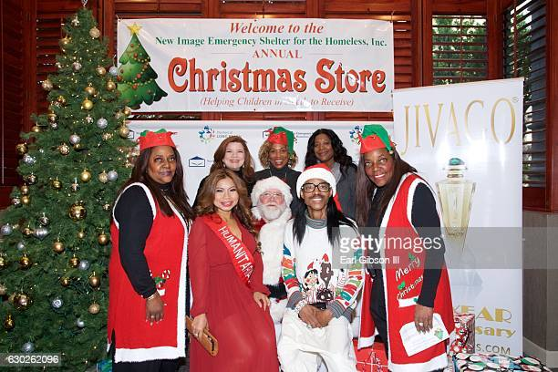Brenda Wilson Renee Lawless Rolanda Watts Leah Daniels Butler Lynda Moran and Wendell James pose for a photo at the New Image Emergency Shelter's...