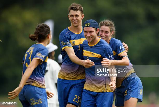 Brendan Ashcroft of Australia celebrates with his team-mates Rob Andrews of Australia and Cat Phillips of Australia after winning the Ultimate Mixed...