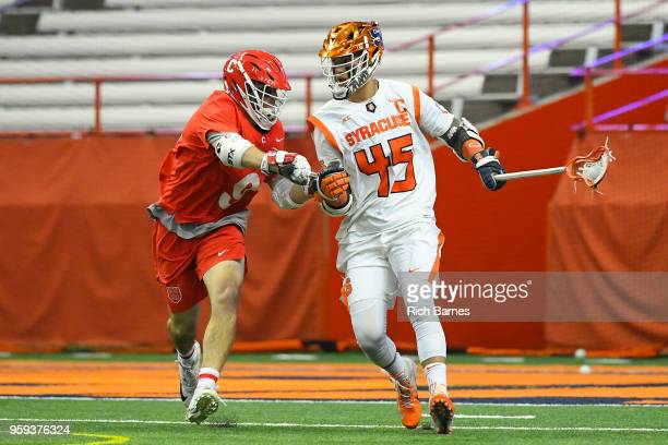 Brendan Bomberry of the Syracuse Orange dodges to the goal against the defense of Jake McCulloch of the Cornell Big Red during a 2018 NCAA Division I...