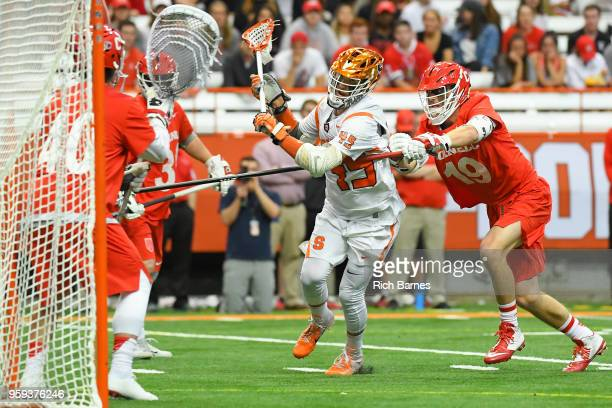 Brendan Bomberry of the Syracuse Orange dodges to the goal past Dom Doria of the Cornell Big Red during a 2018 NCAA Division I Men's Lacrosse...
