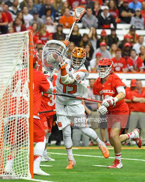 Brendan Bomberry of the Syracuse Orange shoots the ball in front of Dom Doria of the Cornell Big Red during a 2018 NCAA Division I Men's Lacrosse...