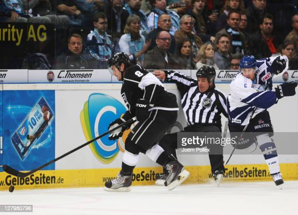 Brendan Brooks of Hamburg tackles Drew Doughty of Los Angeles during the NHL Pre-Season game between Hamburg Freezers and Los Angeles Kings at the O2...