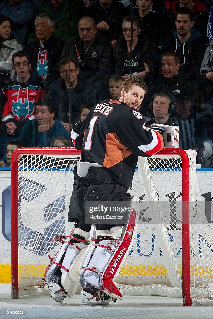 Brendan Burke #1 of Calgary Hitmen stands in net at the timeout against the Kelowna Rockets on February 28, 2015 at Prospera Place in Kelowna, British Columbia, Canada.