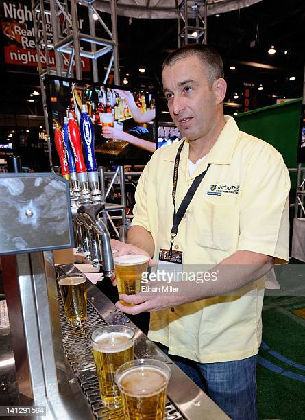 Brendan Card from TurboTap USA pours a beer at the 27th annual Nightclub Bar Convention and Trade Show at the Las Vegas Convention Center on March 13...