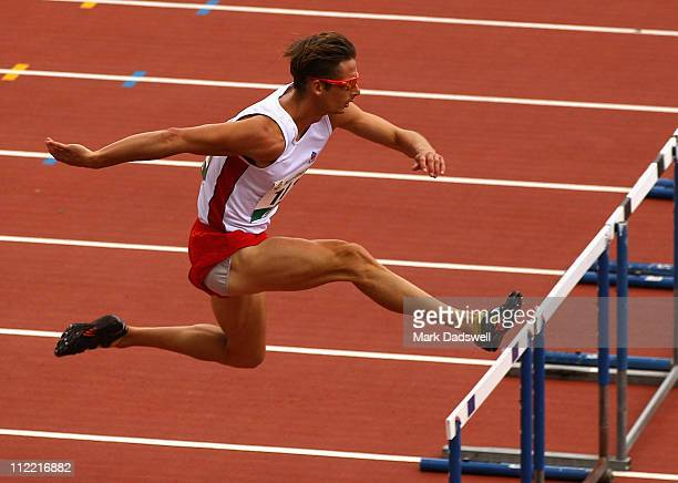 Brendan Cole of the AIS competes in the Mens 400 Metres Hurdles Open Preliminaries during day one of the Australian Athletics National Campionships...