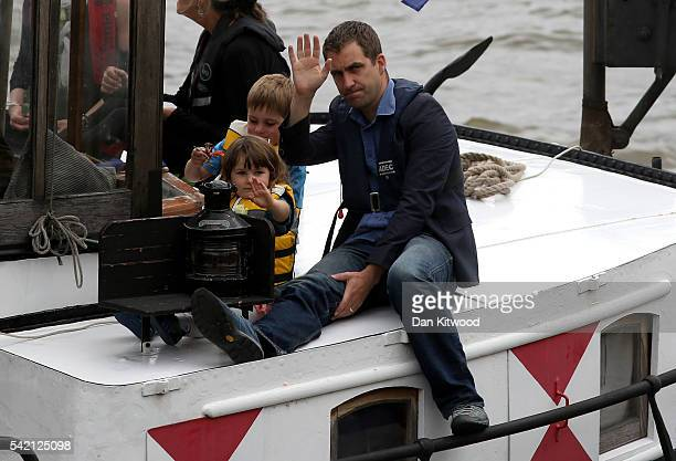 Brendan Cox, husband of murdered Labour MP Jo Cox, and their children Cuillin Cox and Lejla Cox ride on the boat towing a memorial dedicated to Jo...