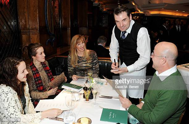 Brendan Coyle waits tables during One Night Only at The Ivy in aid of Acting For Others supported by Tanqueray No TEN at The Ivy on December 1 2013...