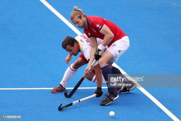 Brendan Creed of Great Britain and Alvaro Iglesias of Spain battle for possession during the Men's FIH Field Hockey Pro League match between Great...