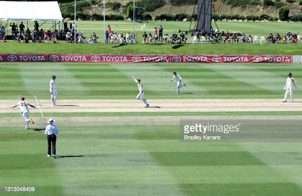 Brendan Doggett of Queensland celebrates taking the final wicket of the match of Josh Hazlewood of New South Wales as the players celebrate victory...