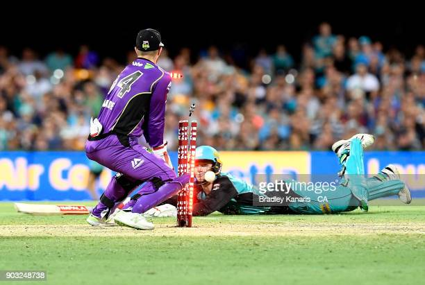 Brendan Doggett of the Heat makes his ground during the Big Bash League match between the Brisbane Heat and the Hobart Hurricanes at The Gabba on...
