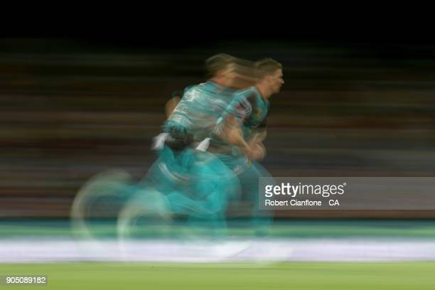 Brendan Doggett of the Heat runs in to bowl during the Big Bash League match between the Hobart Hurricanes and the Brisbane Heat at Blundstone Arena...