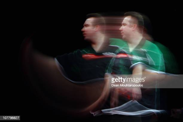 Brendan Dolan of Ireland in action against Wes Newton of England during day 10 in the 2011 Ladbrokescom World Darts Championship at Alexandra Palace...
