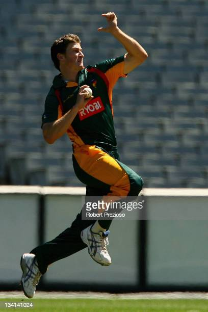 Brendan Drew of the Tigers bowls during the Ryobi One Day Cup match between the Victoria Bushrangers and the Tasmania Tigers at Melbourne Cricket...