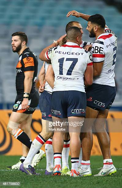 Brendan Elliot of the Roosters celebrate with is team after scoring a try during the round 20 NRL match between the Wests Tigers and the Sydney...