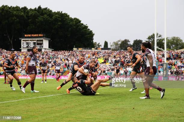 Brendan Elliot of the Sea Eagles is tackled during the round 1 NRL match between the Wests Tigers and the Manly Warringah Sea Eagles at Leichhardt...