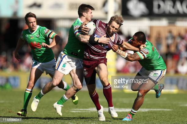 Brendan Elliot of the Sea Eagles is tackled during the round 7 NRL match between the Manly Warringah Sea Eagles and the Canberra Raiders at Lottoland...