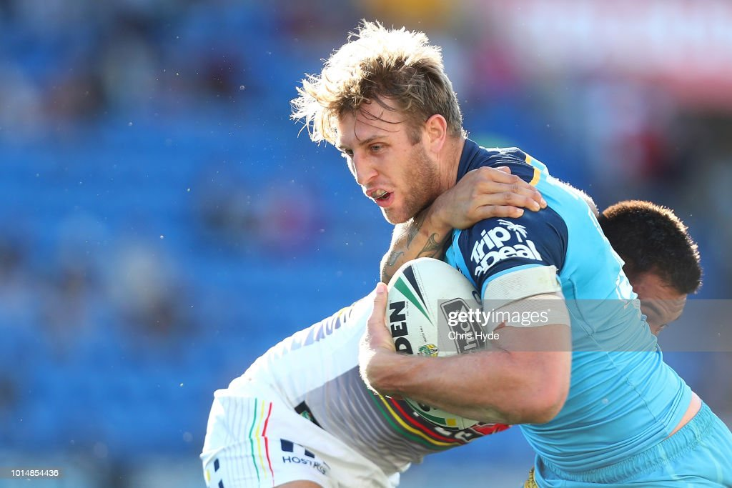 Brendan Elliot of the Titans is tackled during the round 22 NRL match between the Gold Coast Titans and the Penrith Panthers at Cbus Super Stadium on August 11, 2018 in Gold Coast, Australia.