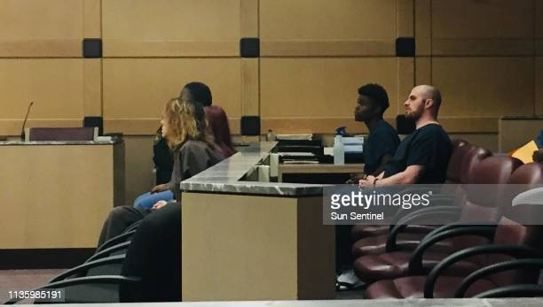 Brendan Evans far right the Hollywood man accused of killing Ollie the pit bull on Oct 10 makes a rare court appearance on Tuesday April 9 2019 in...