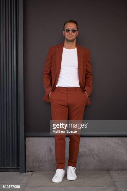 Brendan Fallis is seen attending BOSS during Men's New York Fashion Week wearing Hugo Boss on July 11 2017 in New York City