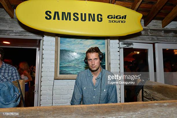 Brendan Fallis performs in the DJ booth during Samsung's Summer DJ Series to launch the Giga Sound System at Surf Lodge on July 13 2013 in Montauk...
