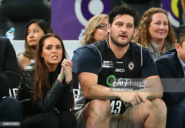 Brendan Fevola and Mia Fevola watch from the crowd during the round seven NBL match between Melbourne United and the Townsville Crocodiles at Hisense...