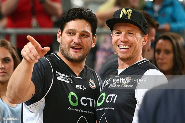 Brendan Fevola and Peter Siddle attend the round 11 NBL match between Melbourne United and Sydney Kings at Hisense Arena on December 16 2015 in...