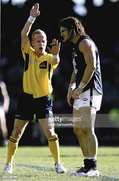 Brendan Fevola for Carlton is spoken to by the umpire during the AFL Round 15 match between the St Kilda Saints and Carlton Blues at the Telstra Dome...