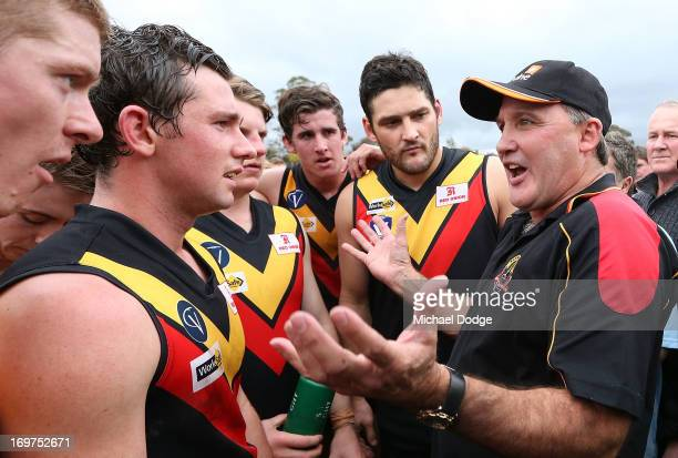 Brendan Fevola of Bacchus Marsh listens to coach and Western Bulldogs legend Doug Hawkins speak in a quarter time huddle during the round six BFL...