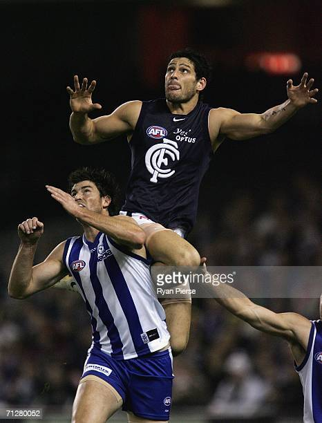 Brendan Fevola of the Blues flies for a mark during the round twelve AFL match between the Kangaroos and Carlton Blues at the Telstra Dome June 23...