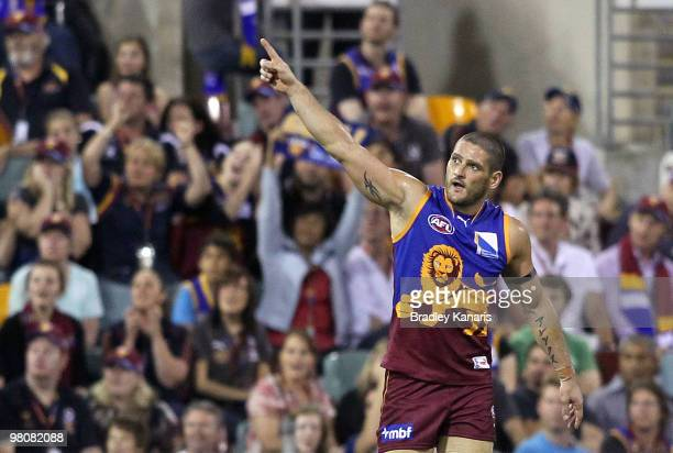 Brendan Fevola of the Lions celebrates after scoring a goal during the round one AFL match between the Brisbane Lions and the West Coast Eagles at...