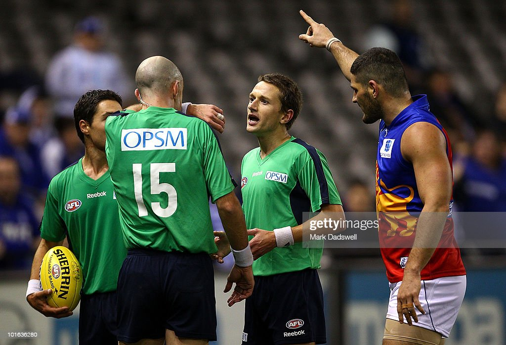 Brendan Fevola of the Lions tells Umpire Matthew Nicholls to look at the big screen replayduring the round 11 AFL match between the North Melbourne Kangaroos and the Brisbane Lions at Etihad Stadium on June 5, 2010 in Melbourne, Australia.