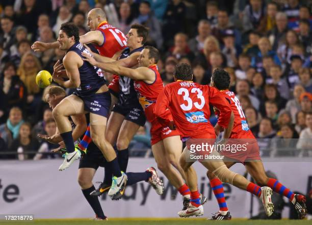 Brendan Fevola of Victoria attempts to take a mark during the EJ Whitten Legends AFL game between Victoria and the All Stars at Etihad Stadium on...