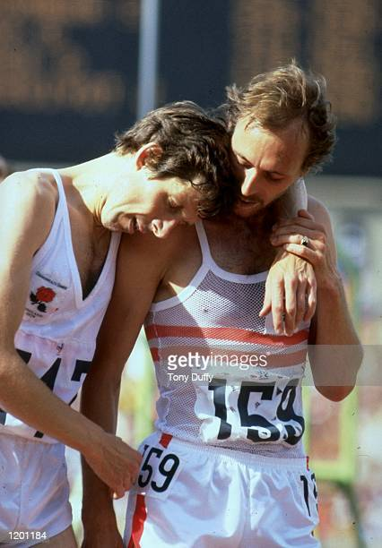 Brendan Foster and Mike McLeod of England recover after the Mens 10000 metres event during the Commonwealth Games in Edmonton Canada Foster won the...