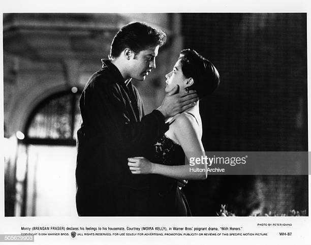 Brendan Fraser and Moira Kelly get close on campus in a scene from the Warner Bros movie 'With Honors' circa 1994
