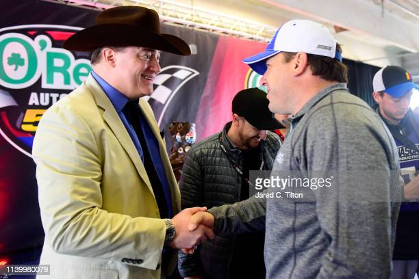 Brendan Fraser of DC Universe's Doom Patrol meets with NASCAR driver Ryan Newman before the Monster Energy NASCAR Cup Series O'Reilly Auto Parts 500...