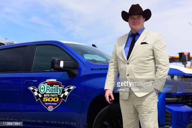 Brendan Fraser of DC Universe's Doom Patrol poses for photos during the pace car practice before the Monster Energy NASCAR Cup Series O'Reilly Auto...