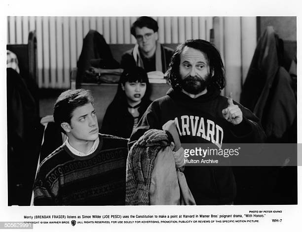 Brendan Fraser watches as Joe Pesci speaks up in class in a scene from the Warner Bros movie 'With Honors' circa 1994