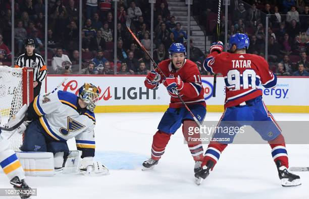 Brendan Gallagher and Tomas Tatar of the Montreal Canadiens celebrate after scoring a goal against Jake Allen of the St Louis Blues in the NHL game...