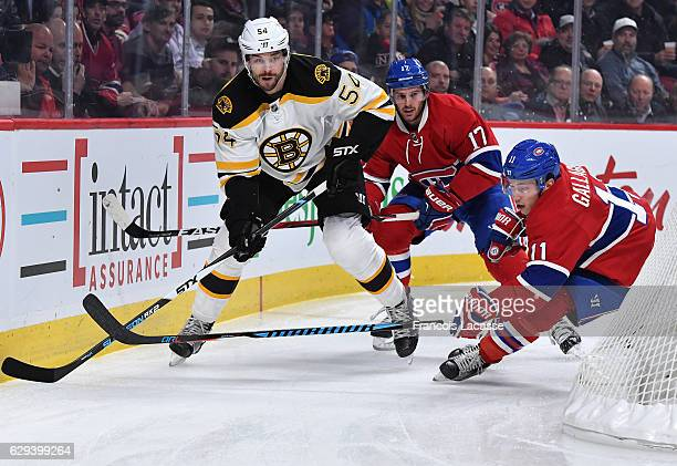 Brendan Gallagher and Torrey Mitchell of the Montreal Canadiens skate against Adam Mcquaid of the Boston Bruins in the NHL game at the Bell Centre on...