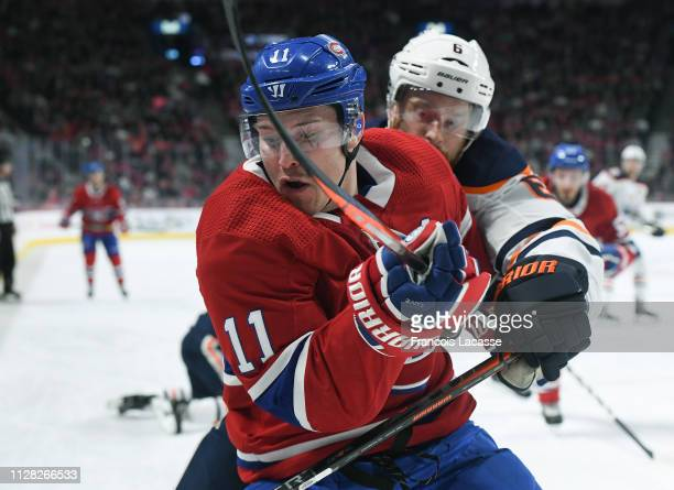 Brendan Gallagher of the Montreal Canadiens and Adam Larsson of the Edmonton Oilers battle for position in the NHL game at the Bell Centre on...