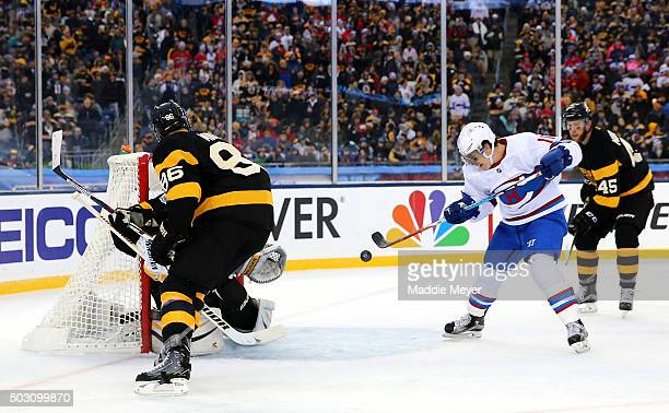 Brendan Gallagher of the Montreal Canadiens bats the puck to score his team's third goal against the Boston Bruins in the second period during the...