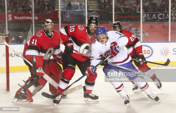 Brendan Gallagher of the Montreal Canadiens battles for position with Tom Pyatt of the Ottawa Senators in front of teammate Craig Anderson during the...