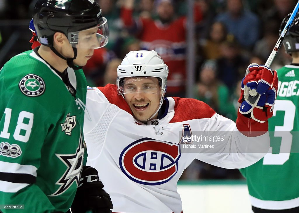 Brendan Gallagher #11 of the Montreal Canadiens celebrates a goal in front of Tyler Pitlick #18 of the Dallas Stars in the second period at American Airlines Center on November 21, 2017 in Dallas, Texas.
