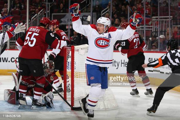 Brendan Gallagher of the Montreal Canadiens celebrates after scoring a goal against goaltender Antti Raanta of the Arizona Coyotes during the first...
