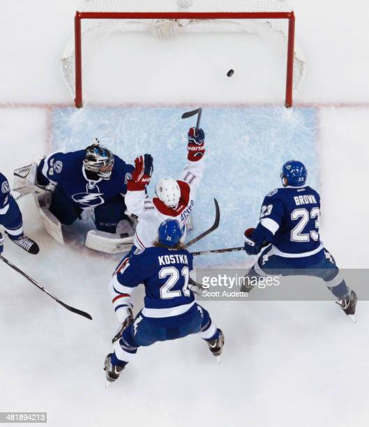 Brendan Gallagher of the Montreal Canadiens celebrates his goal against goalie Ben Bishop, Mike Kostka, and J.T. Brown of the Tampa Bay Lightning...