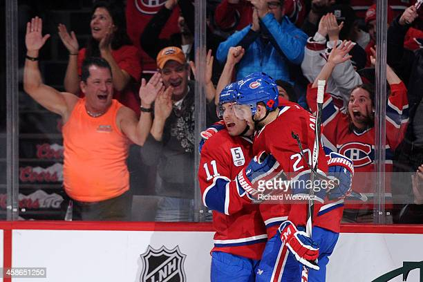 Brendan Gallagher of the Montreal Canadiens celebrates his second period goal with teammate Alex Galchenyuk during the NHL game against the Minnesota...