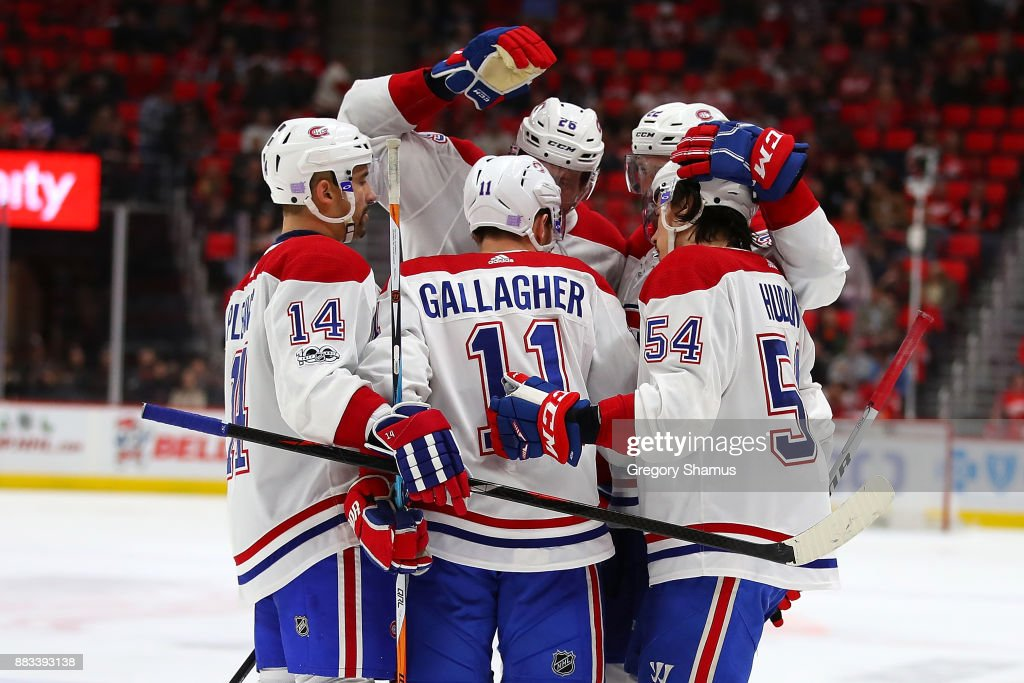 Brendan Gallagher #11 of the Montreal Canadiens celebrates his third period goal with teammates while playing the Detroit Red Wings at Little Caesars Arena on November 30, 2017 in Detroit, Michigan. Montreal won the game 6-3.