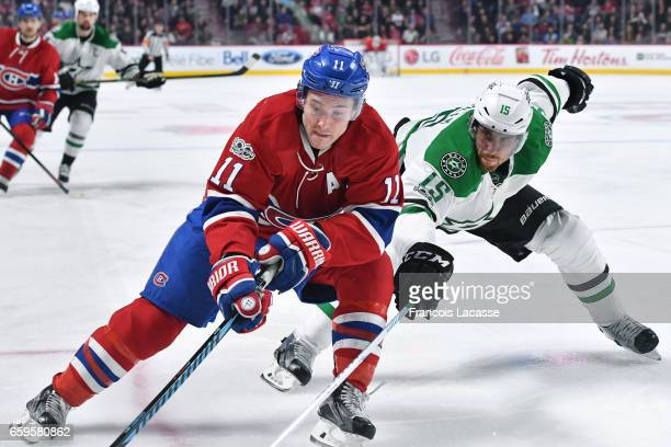 Brendan Gallagher of the Montreal Canadiens controls the puck against Patrik Nemeth of the Dallas Stars in the NHL game at the Bell Centre on March...
